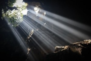 7725852-multiple-light-beams-are-illuminating-the-bottom-of-a-cave-near-hanoi-north-vietnam